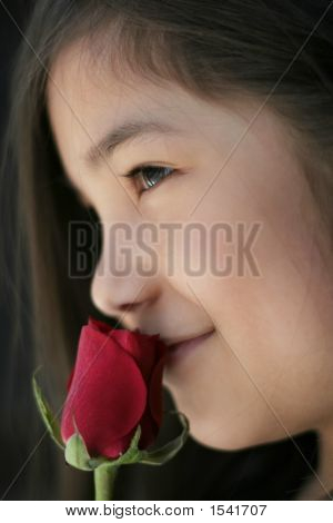 Beautiful Little Girl Enjoying Fragrance Of A Rose, Side Profile