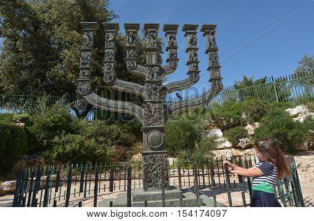 Israeli Jewish girl visit at the Knesset's Menorah sculpture in Jerusalem Israel