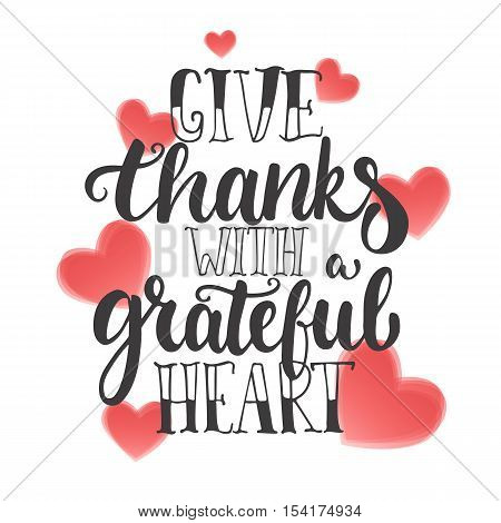 Give thanks with a grateful heart - Thanksgiving day lettering calligraphy phrase. Autumn greeting card isolated on the white background with red hearts