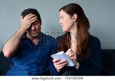 Worried Husband And Wife  Listing Expenses