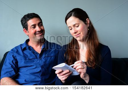 Happy Couple Filling Shopping List