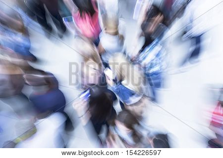 Numerous blurry people representing urban environment and everyday rush