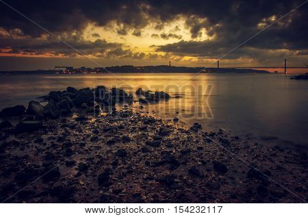 View of Tagus river and 25 of April bridge in Lisbon in the evening