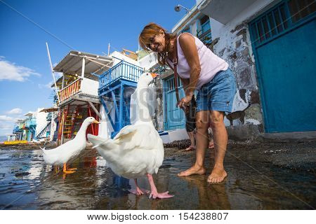 MILOS, GREECE - SEP 25, 2016: Scenic view of traditional fisherman village Klima on the island. Milos - vulcanic island with beautiful beaches, visited by thounds of tourist every year.