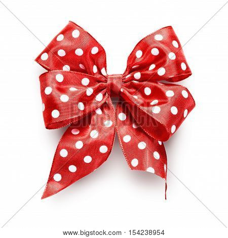 Polka dot red ribbon bow isolated on white background clipping path included