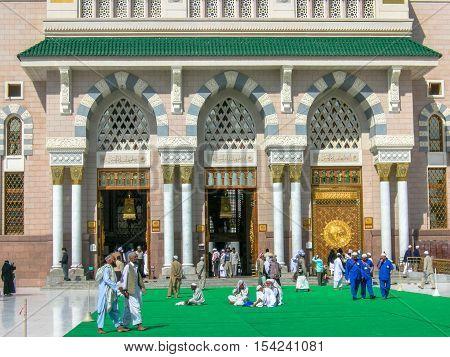 Medina,Saudi Arabia-Nov 11,2008:Pilgrims at Nabawi Mosque Medina,Kingdom of Saudi Arabia.Al-Masjid an-Nabawī is a mosque established and originally built by the Islamic prophet Muhammad, situated in the city of Medina in Saudi Arabia.