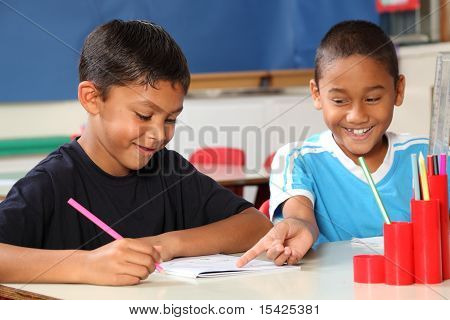 School boys learning in class