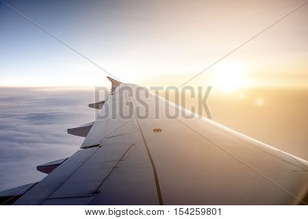 Wing of an airplane on the sky - Stock Photo