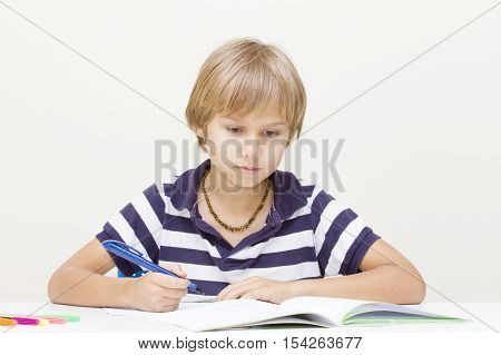 Child at home doing homework. School education concept