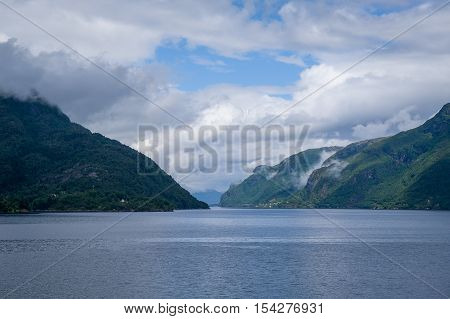 North sea fjord view with green steep shores. Eidfjord, Hordaland, Norway.