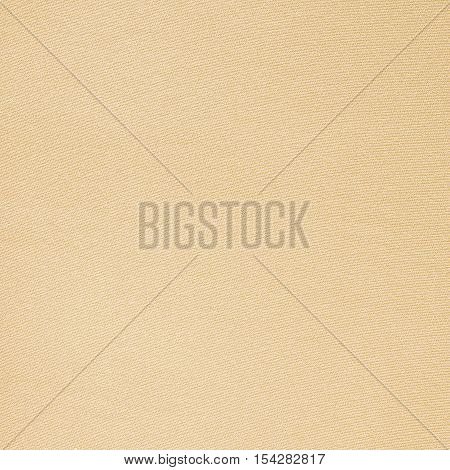 Beige fabric texture closeup. Fashion fabric texture background