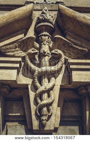 Carved Caduceus Symbol