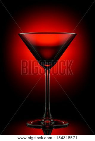 Empty martini glass on a color background.