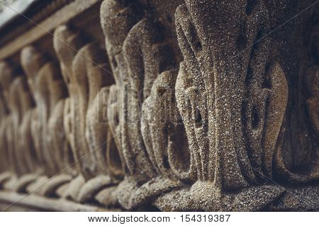 Architectural closeup of classic bas-relief carved ornaments of the public central fountain in Union Square (Piata Unirii) Bucharest Romania. Shallow depth of field selective focus.
