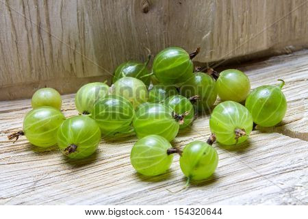 Gooseberry. Gooseberries On A Wooden Background.