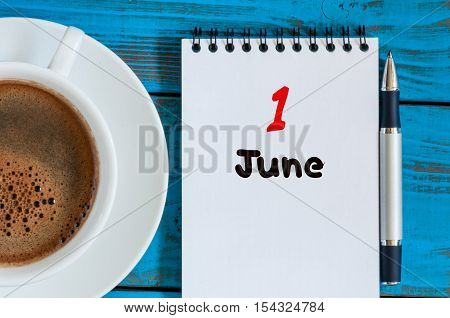 June 1st. Image of june 1, calendar on blue background with morning coffee cup. First summer day. Empty space for text. Happy Childrens Day.