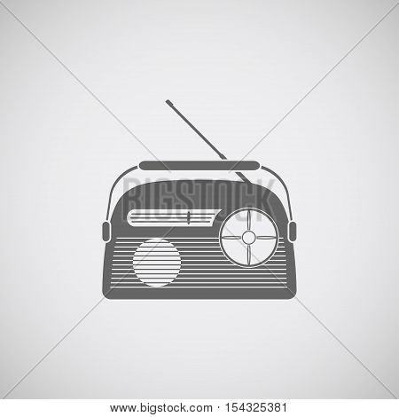 Vector icon of gray radio with antenna on the gradient background.