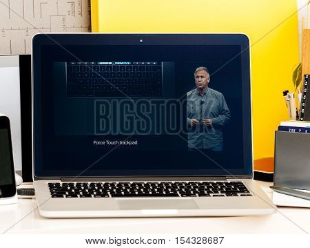 PARIS FRANCE - OCT 28 2016: Apple Computers website on new MacBook Pro Retina with OLED Touch bar in geek creative room showcasing Apple Keynote - Philip Schiller presenting Touch Oled Bar