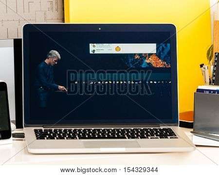PARIS FRANCE - OCT 28 2016: Apple Computers website on new MacBook Pro Retina with OLED Touch bar in geek creative room showcasing Apple Keynote presentation Craig Federighi talking about new MacBook Pro