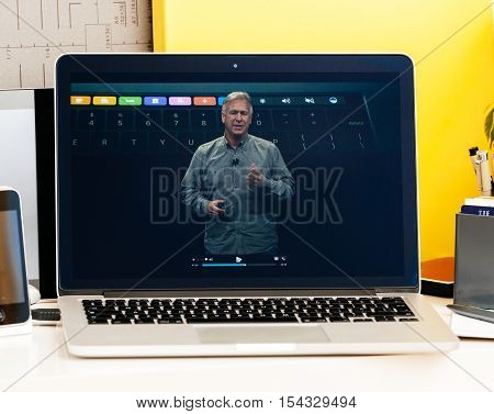 PARIS FRANCE - OCT 28 2016: Apple Computers website on new MacBook Pro Retina with OLED Touch bar in geek creative room showcasing Apple Keynote presentation of philip Schiller talking about oled bar integration