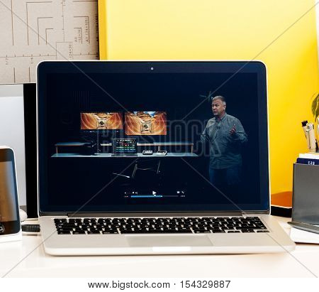 PARIS FRANCE - OCT 28 2016: Apple Computers website on new MacBook Pro Retina with OLED Touch bar in geek creative room showcasing Apple Keynote presentation of Thunderbolt 3 connection speed