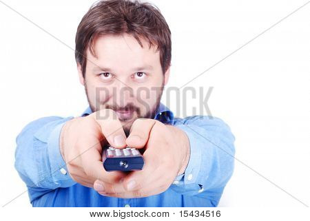 Smiling young man with remote control in hands