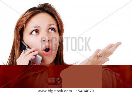 Young brunette with surprised expression on face speaking on cell phone