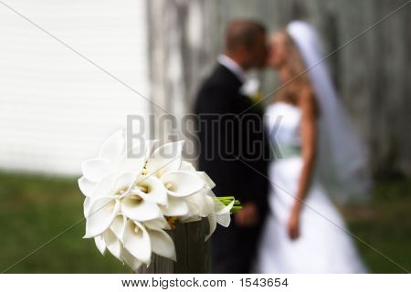 Bouquet With Couple Kissing