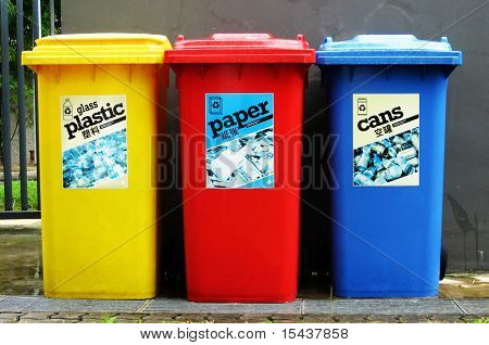 Recycle, reuse, reduce.  Colourful recycle bins.