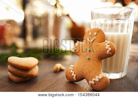 Glass of milk with cookies on table, Christmas breakfast. Traditional treat for Santa Claus. Home, childhood, sweet concept