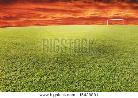 Football field with dynamic sky above