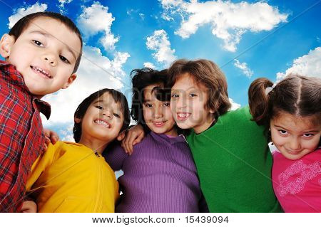 Happy group of children outdoor, beautiful sky behind them