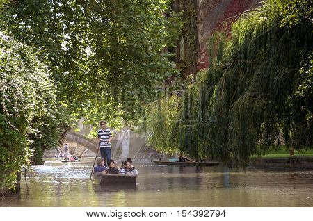 Cambridge, Uk - July 22, 2015: Punting In Summer On The River Cam. There Are Several Companies On Th