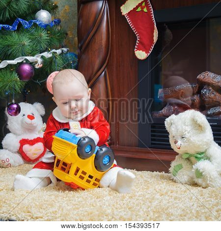 Little Beautiful Baby In Costume Santa Claus