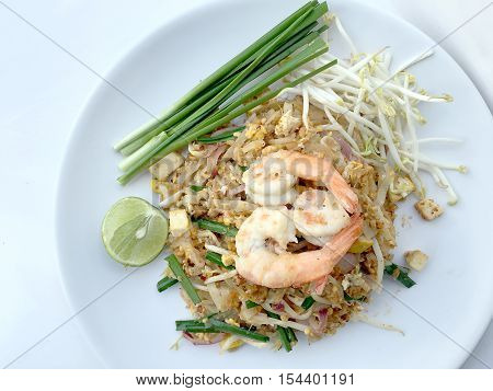 Pad Thai, Stir-fried Rice Noodles With Shrimp In White Dish On White Background. The One Of Thailand