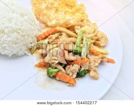 Stir Fry Vegetables With Chicken Fillet, Fried Egg With Rice In White Dish On White Background.