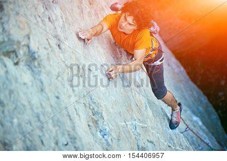 male rock climber. rock climber climbs on a rocky wall