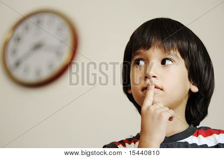Now is the time? Kid and clock: preschool child preparing for the school
