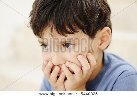 Autism, kid looking far away without interesting