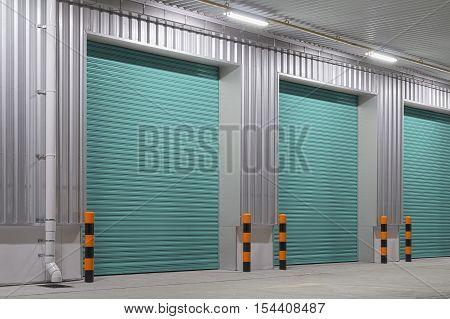 Shutter door or roller door and concrete floor outside factory building use for industrial background.