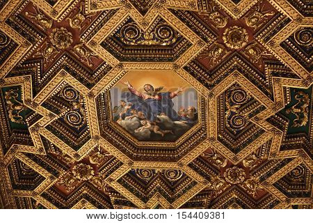 ROME, ITALY - JUNE 12, 2015: interiors and architectural details of basilica di Santa Maria in Trastevere in Rome Italy. Octagonal ceiling painting Assumption by Domenichino