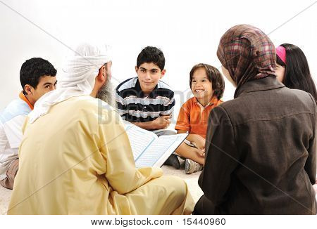 Education activity in Ramadan, Muslim arabic couple and children reading Koran
