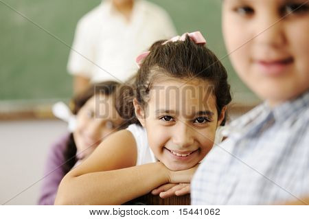 Happy friends and colleagues in classroom, male and female, smiling
