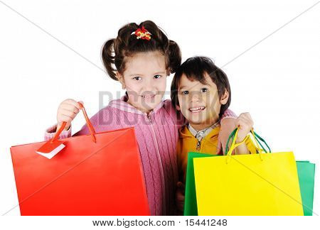 a smiling little girl and boy isolated on white background with shopping bags