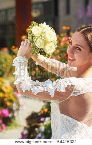 Snippets of a bride who raises just a bridal bouquet.