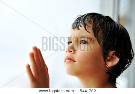 Kid on window waiting