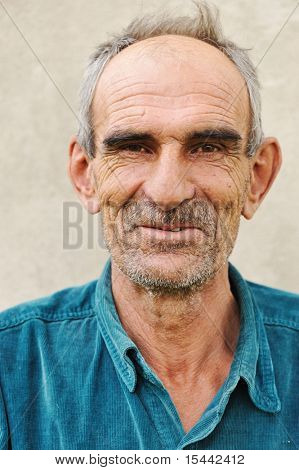 Elderly bald man, natural smile and positive grimace