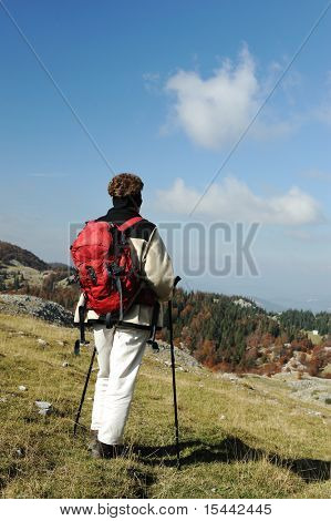 Female on the peak of mountain. Landscape composition.