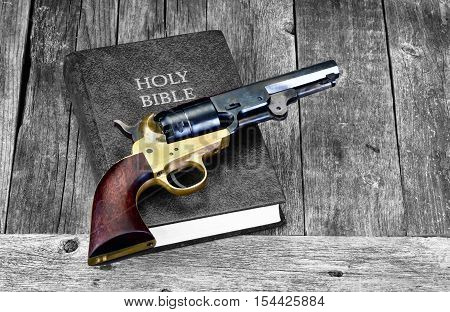 Old Western pistol on Holy Bible with room for your type.