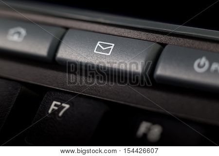 button to send an e-mail on a dark keyboard